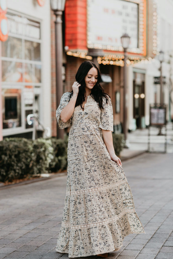 woman with black hair, wearing a long white dress with floral print, standing on a paved sidewalk, easter dresses 2019