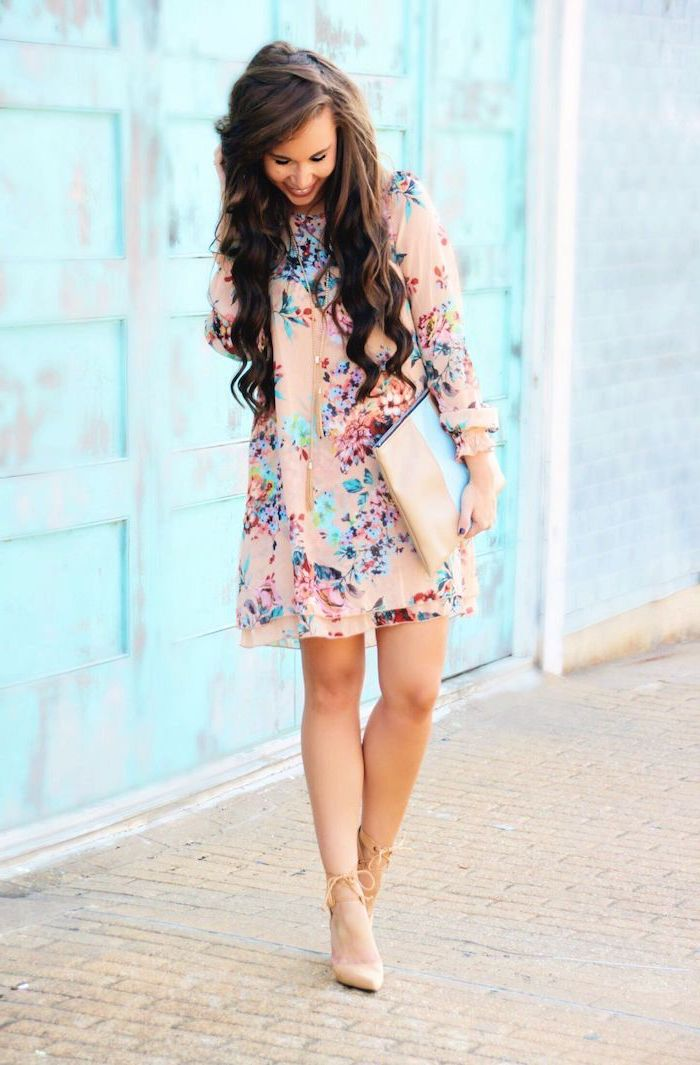 woman with long wavy brown hair, easter dresses 2019, wearing a pink dress with floral print, nude heels