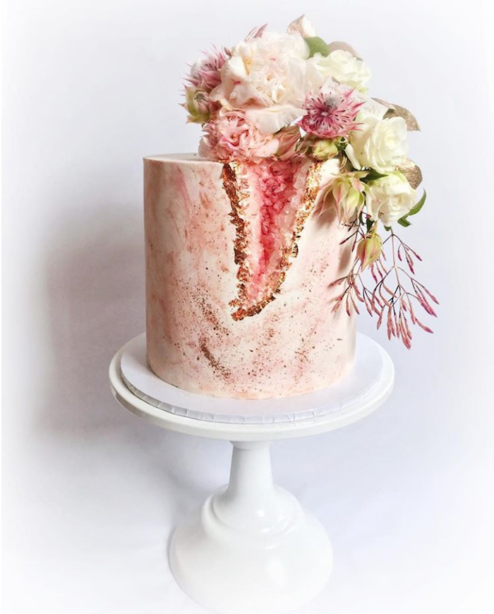 marble geode cake, one tier cake, covered with pink and white marble fondant, decorated with pink rock candy and flowers