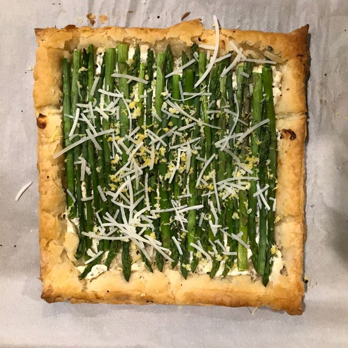 puff pastry with asparagus and cheese inside, easter dinner ideas 2019, placed on white baking paper