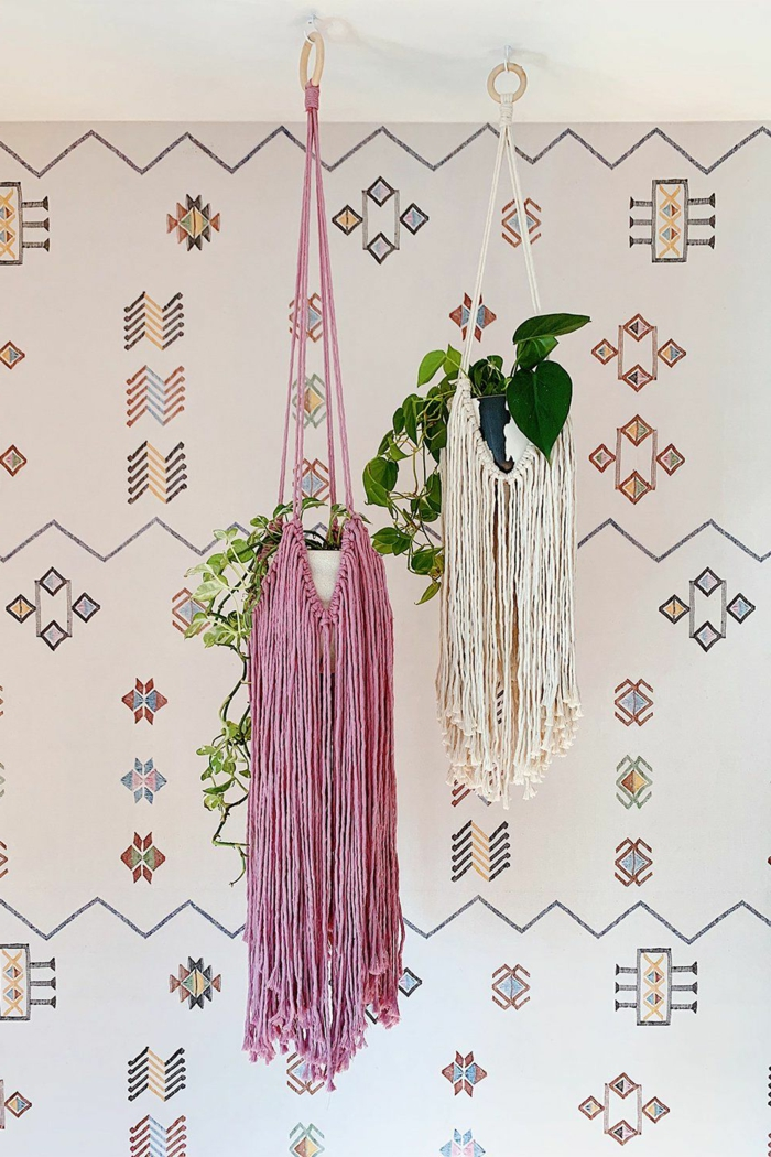 pink and white tassel hangers, hanging from the ceiling, wall with patterns in the background, 5 minute macrame plant hanger