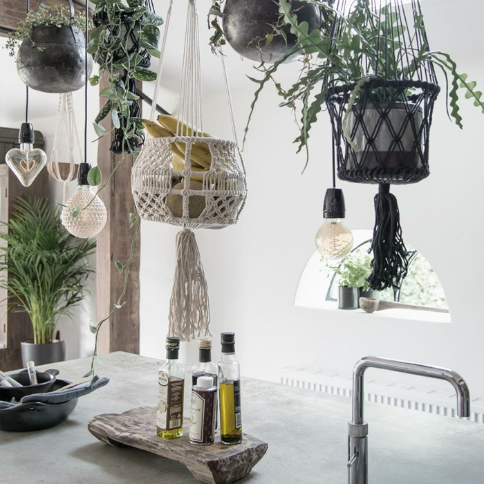 different plants hanging above a kitchen island, 5 minute macrame plant hanger, oil and vinegar bottle on top