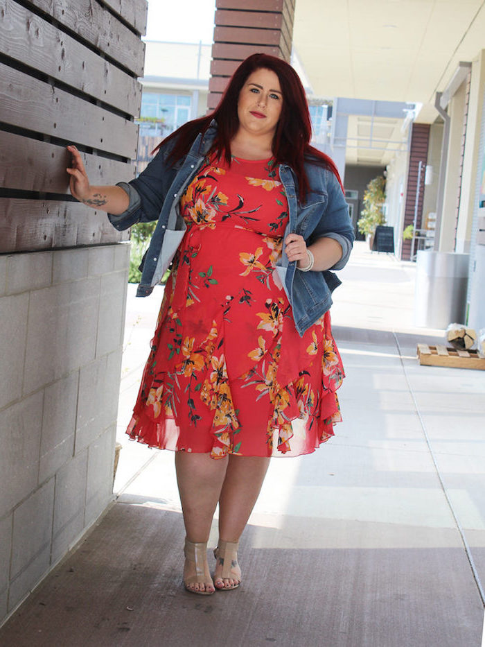 woman with red hair, wearing a pink dress with floral print, pretty dresses for women, denim jacket on top