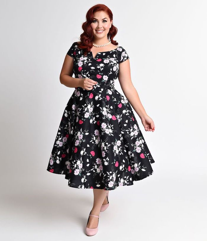 woman with redy wavy hair, pretty dresses for women, wearing a black dress with floral print, nude heels