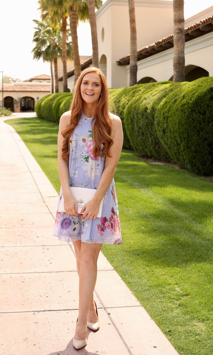 womens easter dresses 2019, woman with a long red hair, wearing a blue dress with a floral print, nude heels