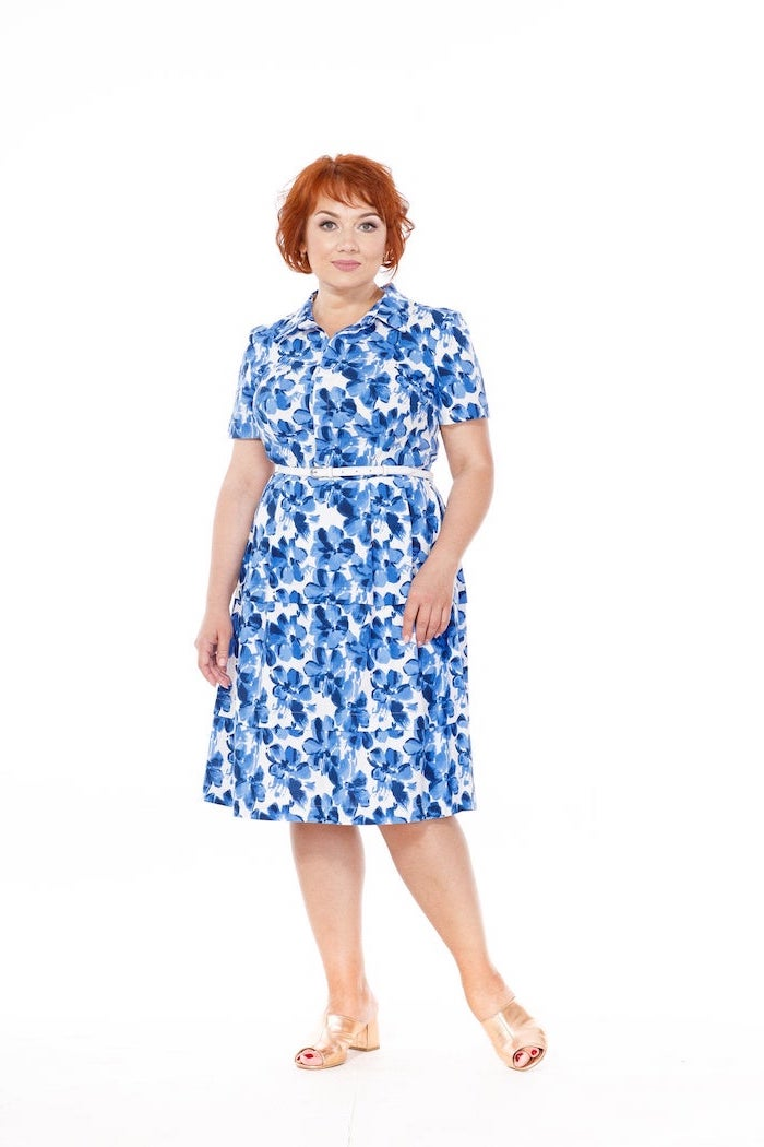 woman with short red hair, wearing a white dress with blue floral print, womens easter dresses 2019, white background