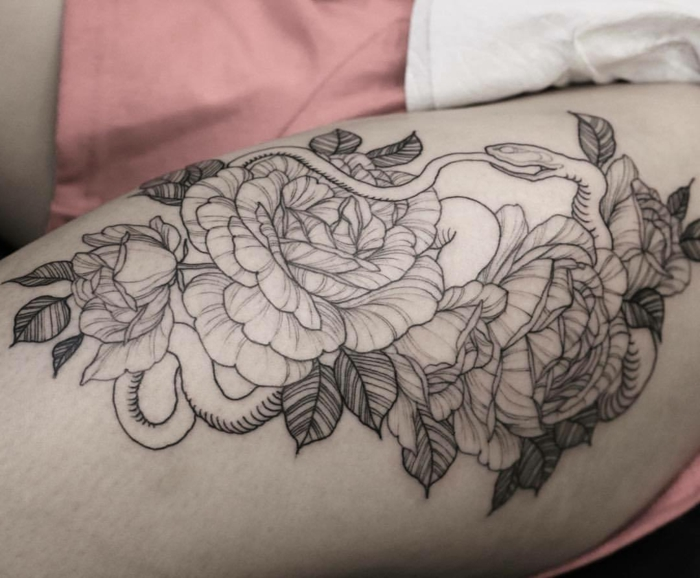snake surrounded by peony flowers, what does ouroboros mean, thigh tattoo