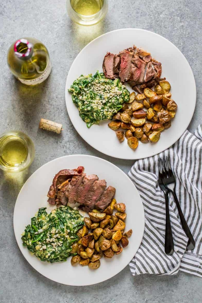 super quick dinner ideas, steak with roasted potatoes, creamy spinach salad on the side, white plates