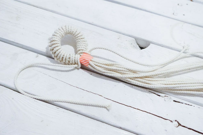 white macrame held together with tape, step by step diy tutorial for different knots, macrame plant hanger