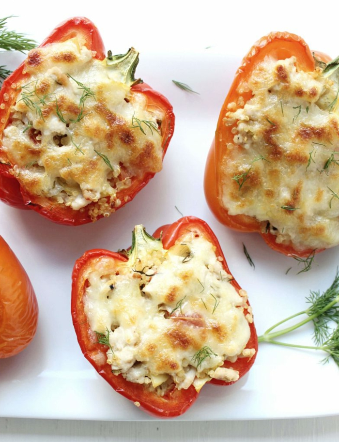 stuffed bell peppers, cut in half and filled with quinoa and cheese, easy weeknight dinners, garnished with dill