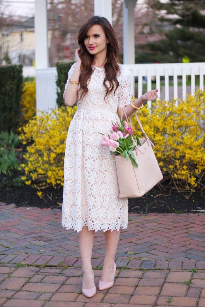 woman with long brown hair, wearing a white lace dress, womens easter dresses 2019, bouquet of tulips inside a leather bag