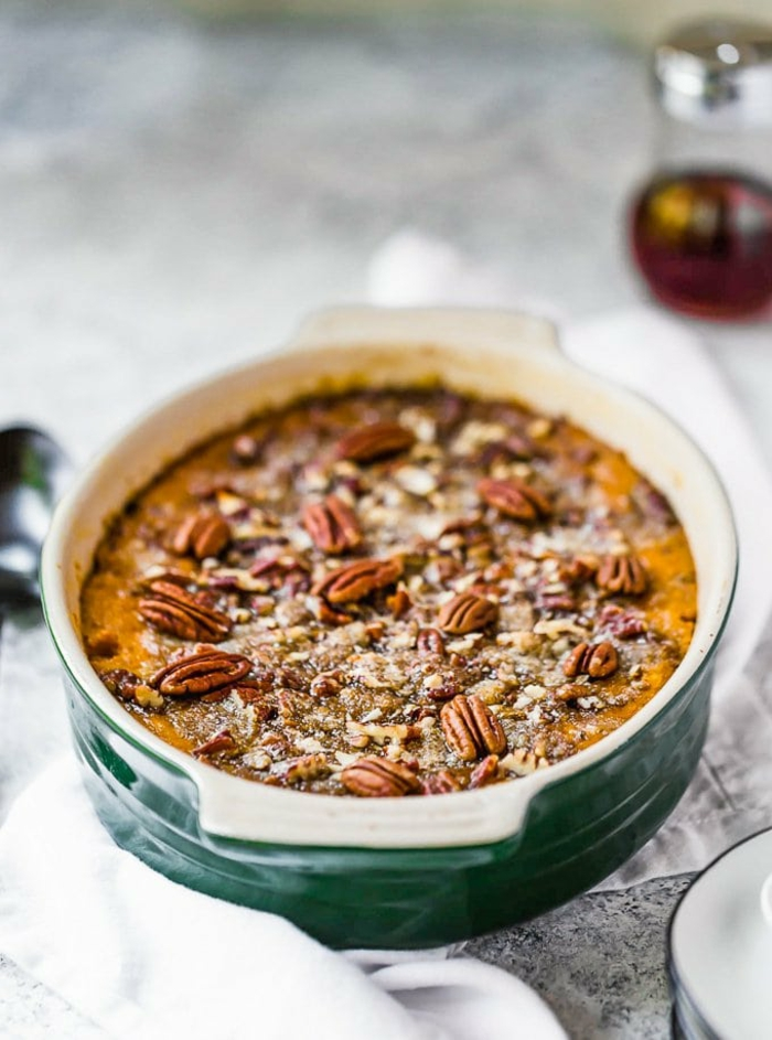 sweet potato casserole with pecans on top, easter dishes, baked in a ceramic casserole dish