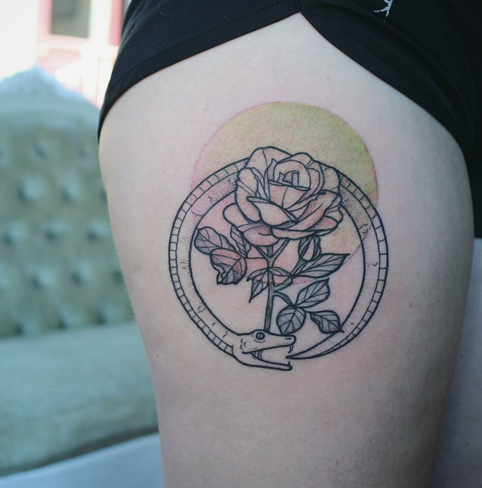 rose surrounded by a snake, red and yellow circle, thigh tattoo, serpent eating its own tail