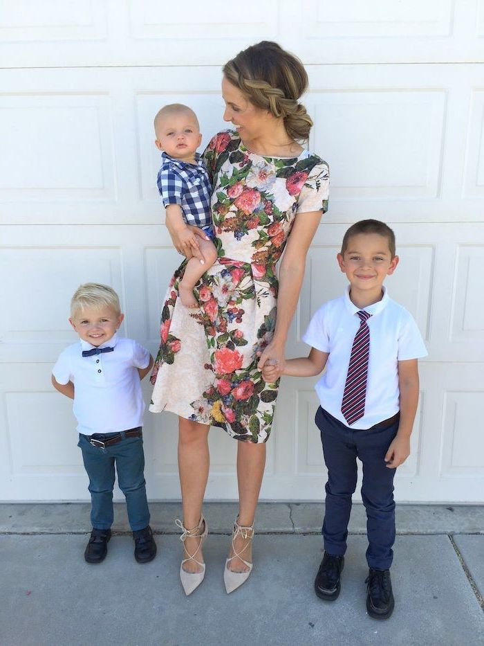 woman holding a baby, two boys next to her, wearing a white dress with floral print, cute easter outfits