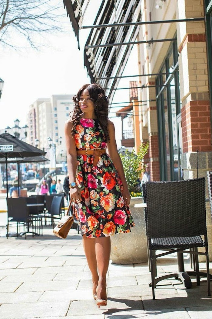 woman walking on a sidewalk, wearing a dress with floral print, cute easter outfits, nude heels