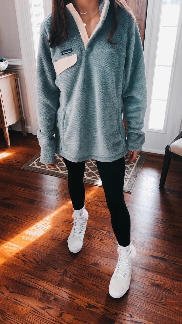 girl wearing black leggings, grey plush sweatshirt, cute lazy outfits, white sneakers, wooden floor