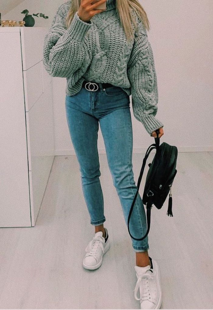 blonde girl wearing jeans, grey knitted sweater, high school cute outfits, white sneakers and black backpack