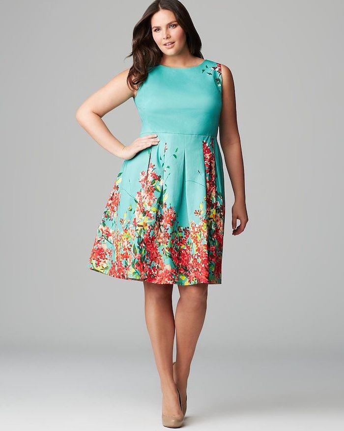 woman with brown wavy hair, wearing bue dress with floral print, cute spring dresses, nude heels