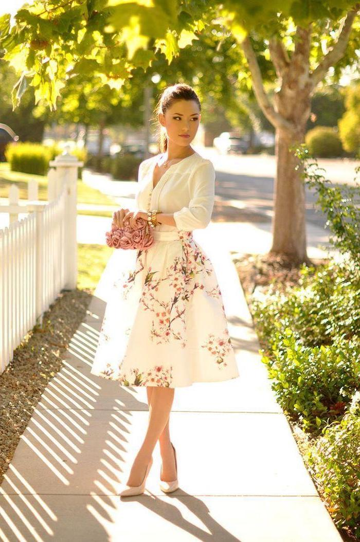 woman with brown hair in ponytail, wearing a white shirt, white skirt with floral print, cute spring dresses