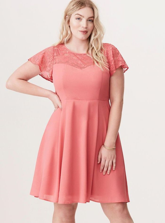 woman with blonde wavy hair, sunflower dress womens, wearing a pink dress with lace sleeves