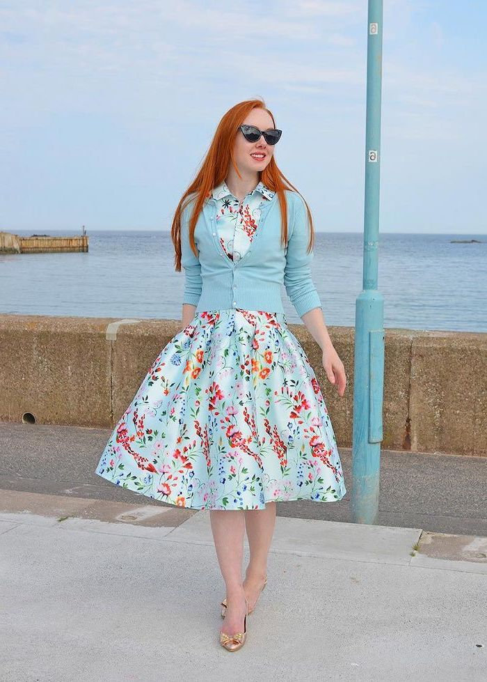 woman with long red hair, wearing blue dress with floral print, sunflower dress womens, blue cardigan