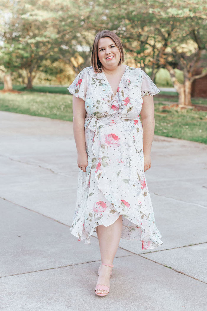 woman with short brown hair, sunflower dress womens, wearing a white wrap dress with floral print, nude heels