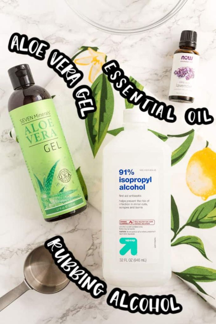 aloe vera gel, essential oil, rubbing alcohol, hand sanitizer ingredients, placed on marble surface