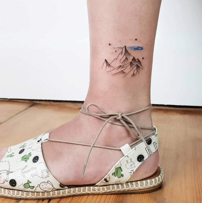 ankle tattoo, mountain range, blue watercolor clouds and stars, mountain range tattoo, white sandals with kawaii print