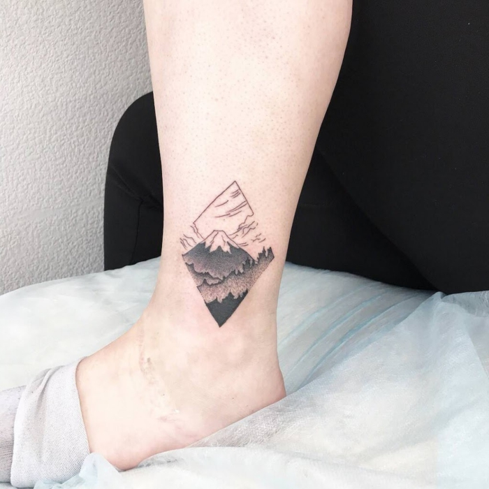 ankle tattoo, geometrical design, simple mountain tattoo, mountain with a snowy peak