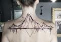 Showcase your adventurous spirit with a mountain range tattoo