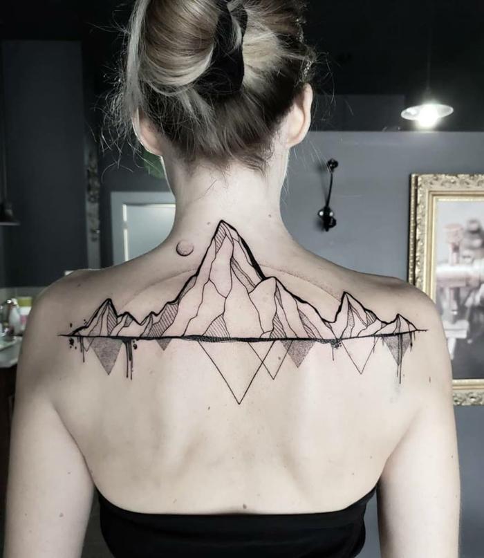 back tattoo, geometrical design, mountain range tattoo, woman with blonde hair in a bun