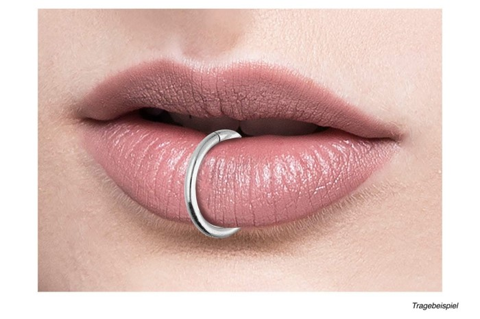 silver ring piercing, lip piercing names, close up photo, lips with pink matte lip gloss
