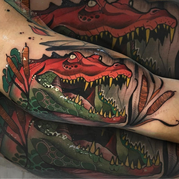 crocodile with an open mouth, swimming in a swamp, traditional tattoo designs, inside arm tattoo