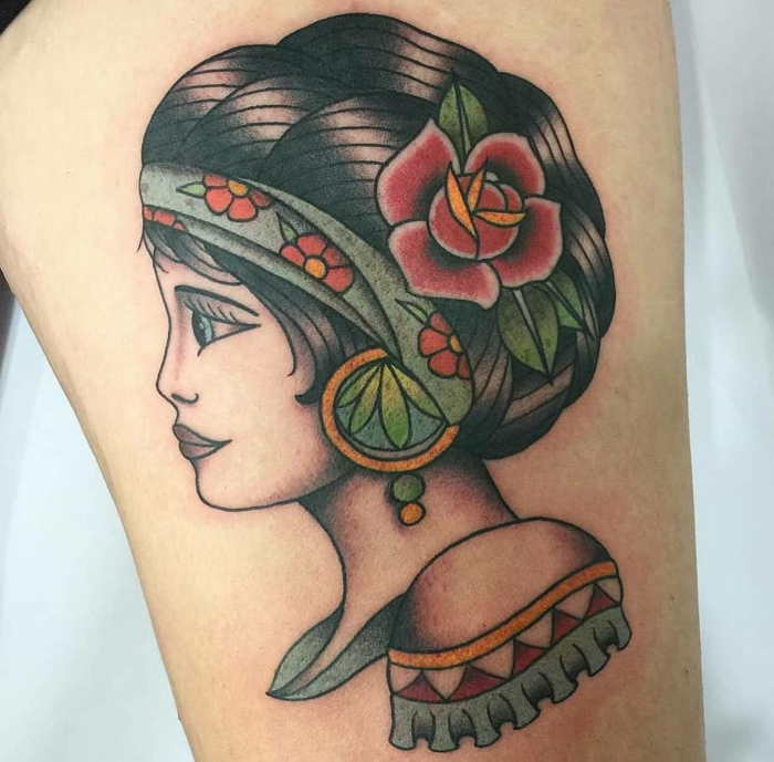 woman with black hair, floral headband and red rose in her hair, traditional tattoo ideas, thigh tattoo