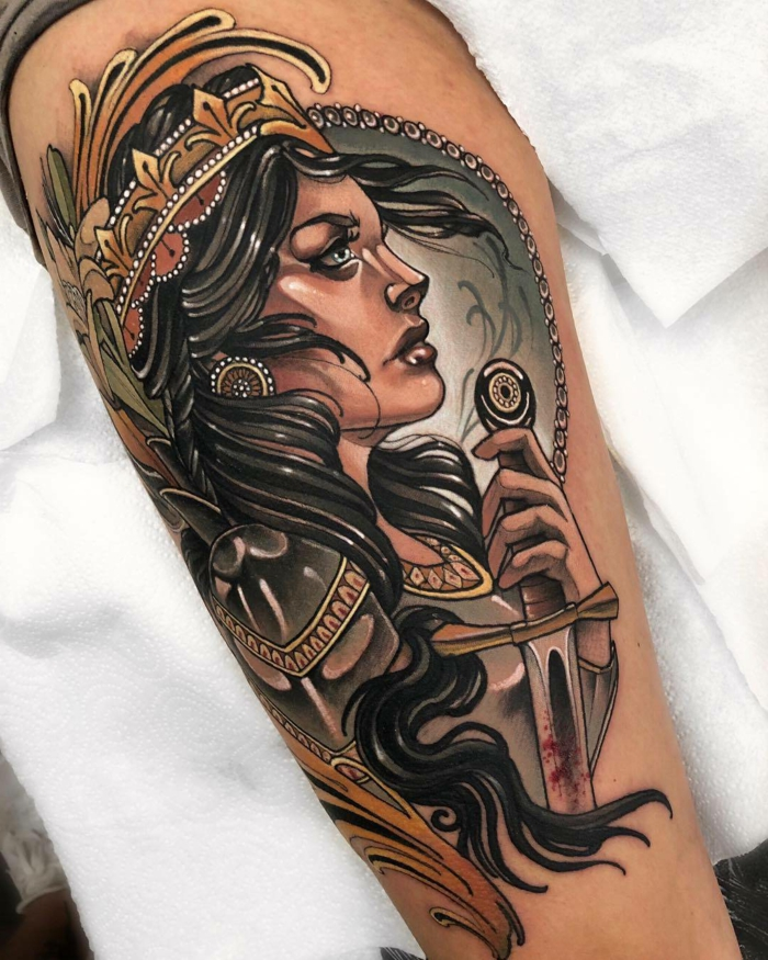 woman warrior with black hair, crown on her head, holding a sword, traditional tattoo ideas