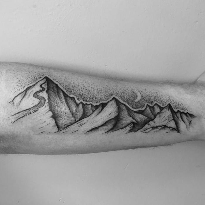 forearm tattoo, simple mountain tattoo, mountain range with a ski slope, black and white photo