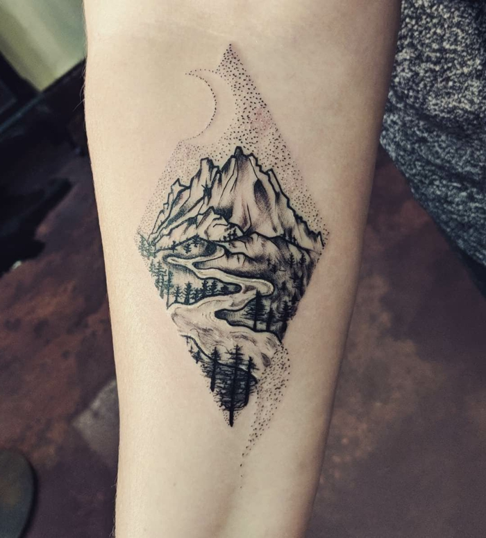river flowing, surrounded by trees, forearm tattoo, small mountain tattoo, crescent moon above mountain