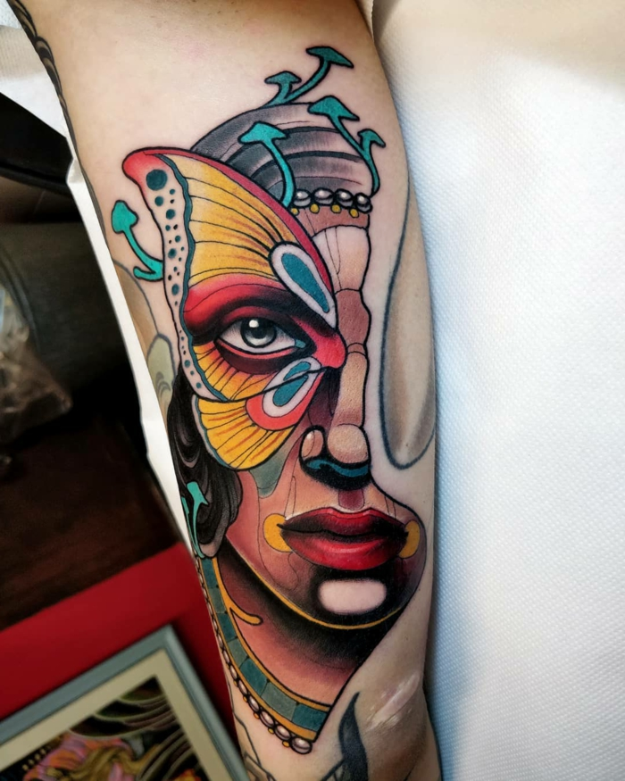 half of a female face with butterfly on her eye, neo traditional tattoo, back of arm tattoo