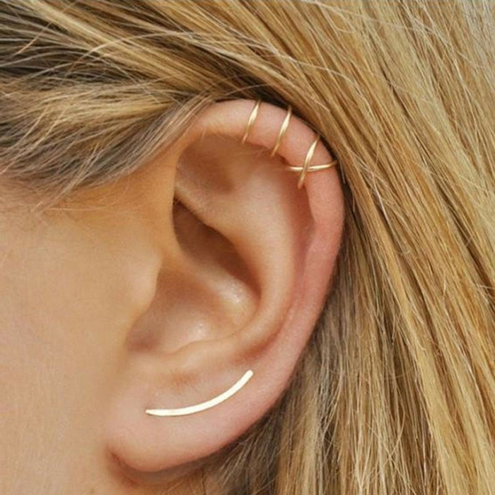 woman with blonde hair, close up photo of an ear, cartilage piercing earrings, gold ring earrings