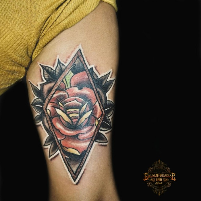 red rose inside the frame, black on the outside, neo traditional animal tattoo, inside arm tattoo