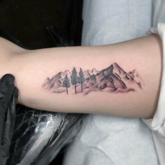 inside the arm tattoo, mountain tattoo sleeve, mountain range with trees