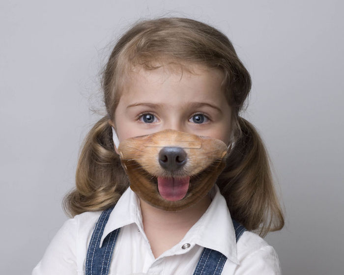 little blonde girl with blue eyes, wearing face mask with a dog face printed on it, how to make a breathing mask