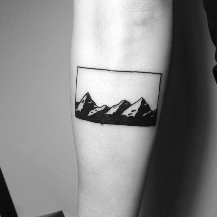 black and white photo, mountain tattoo sleeve, simple mountain range, forearm tattoo
