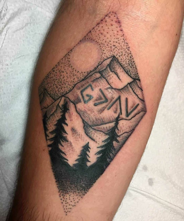 minimalist mountain tattoo, forearm tattoo, mountain range with tall trees, white background