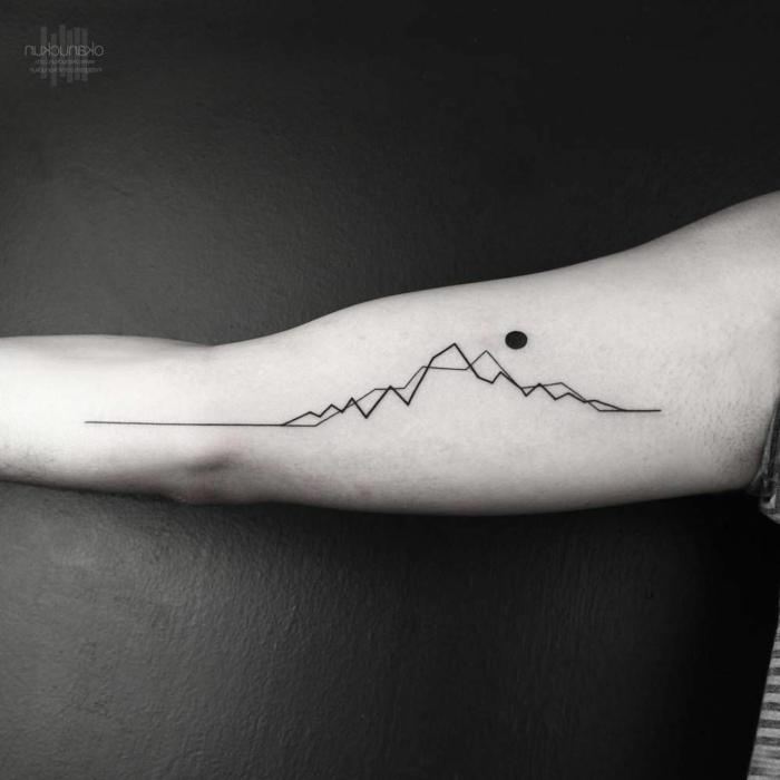 black and white photo, geometrical design, minimalist mountain tattoo, inside the arm tattoo