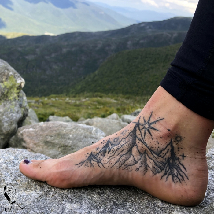 inside the foot tattoo, mountain tattoo ideas, mountain range surrounded by stars