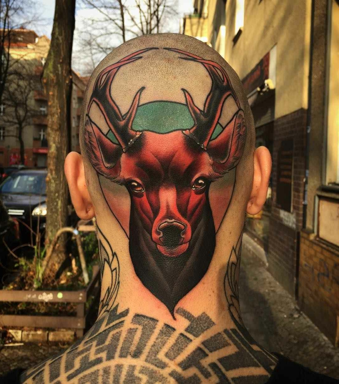 large stag head, back of head tattoo, neo traditional sleeve, man with lots of tattoos