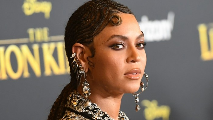 beyonce at the lion king premiere, stud cartilage piercing, hair in brads, wearing multiple earrings with rhinestones