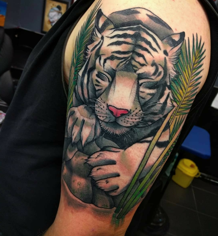 sleeping tiger, surrounded by palm leaves, traditional woman tattoo, arm tattoo