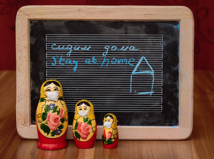 russian dolls with masks, diy face mask for breathing, stay at home written on chalk board